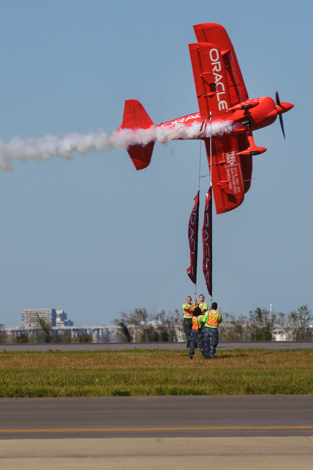 Air show stunt pilot Sean D. Tucker severs one of the three ribbons cut as part of his act's finale during a rehearsal for the Naval Air Station Jacksonville Air Show last week.
