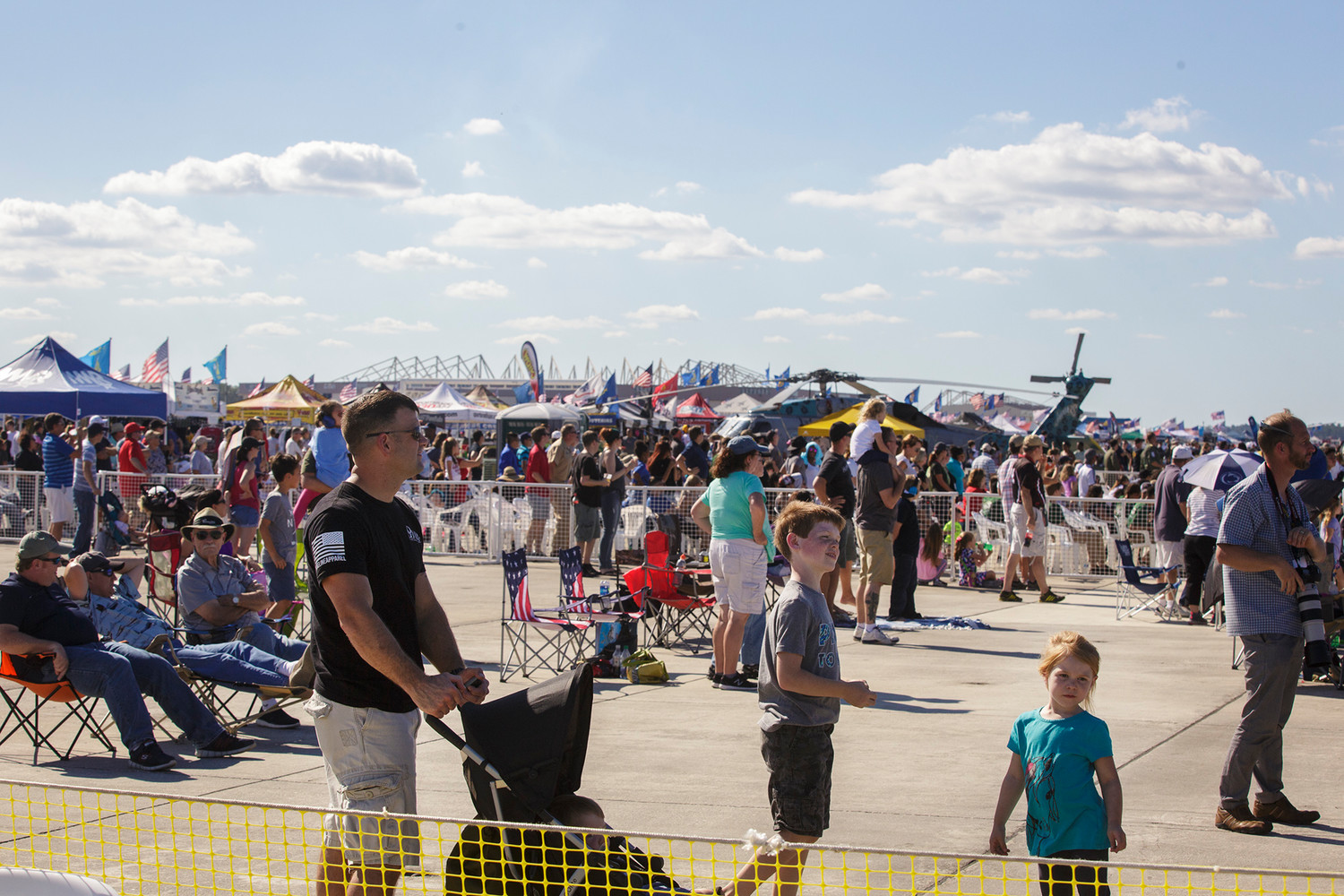 Crowds watch as the Blue Angels board their planes and head onto the runway in preparation for takeoff at Naval Air Station Jacksonville during their annual air show.