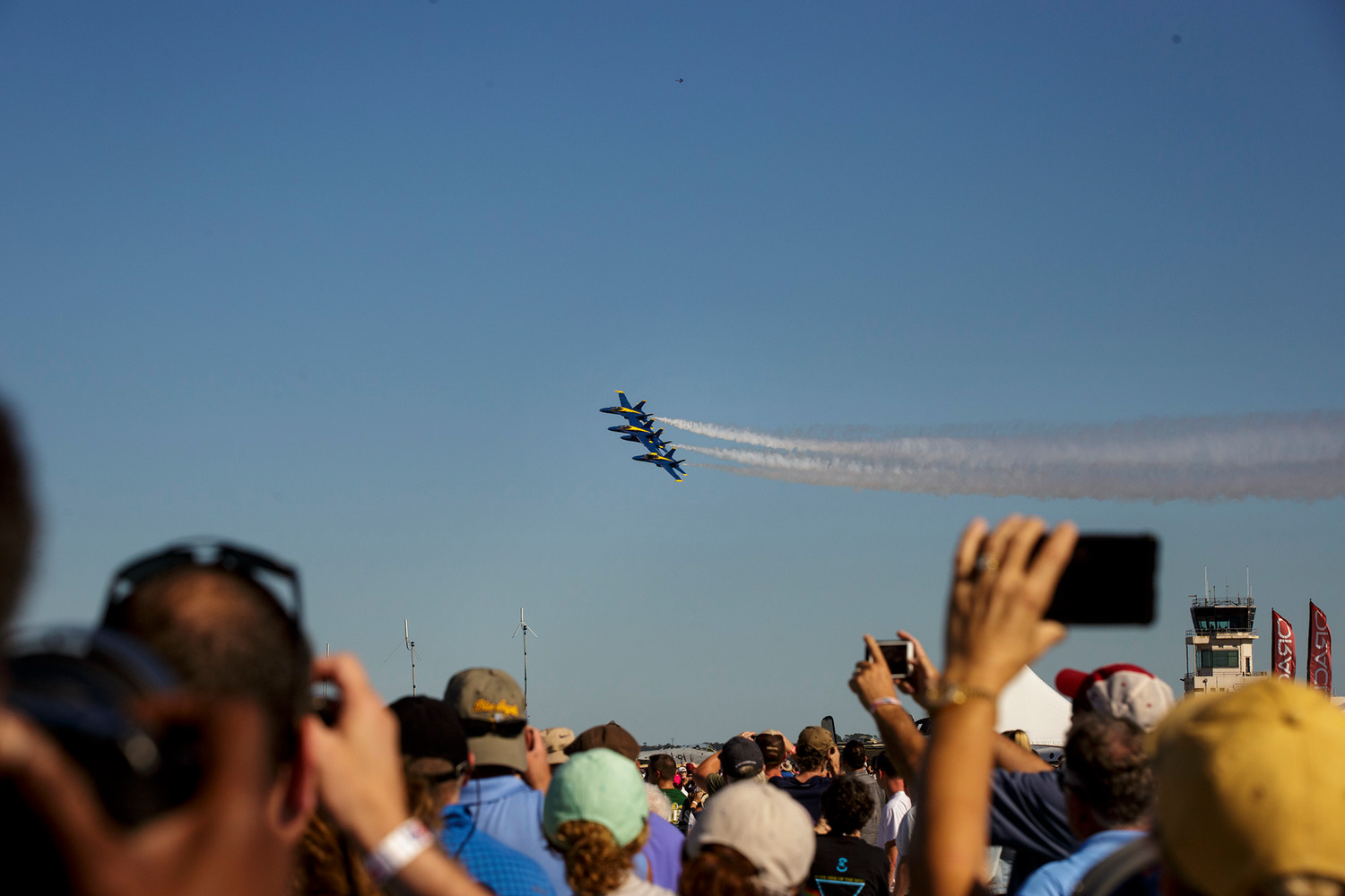 Fans film on their phones and cameras as the Blue Angels diamond formation buzzes over the crowd last week during the Naval Air Station Jacksonville Air Show at the base.