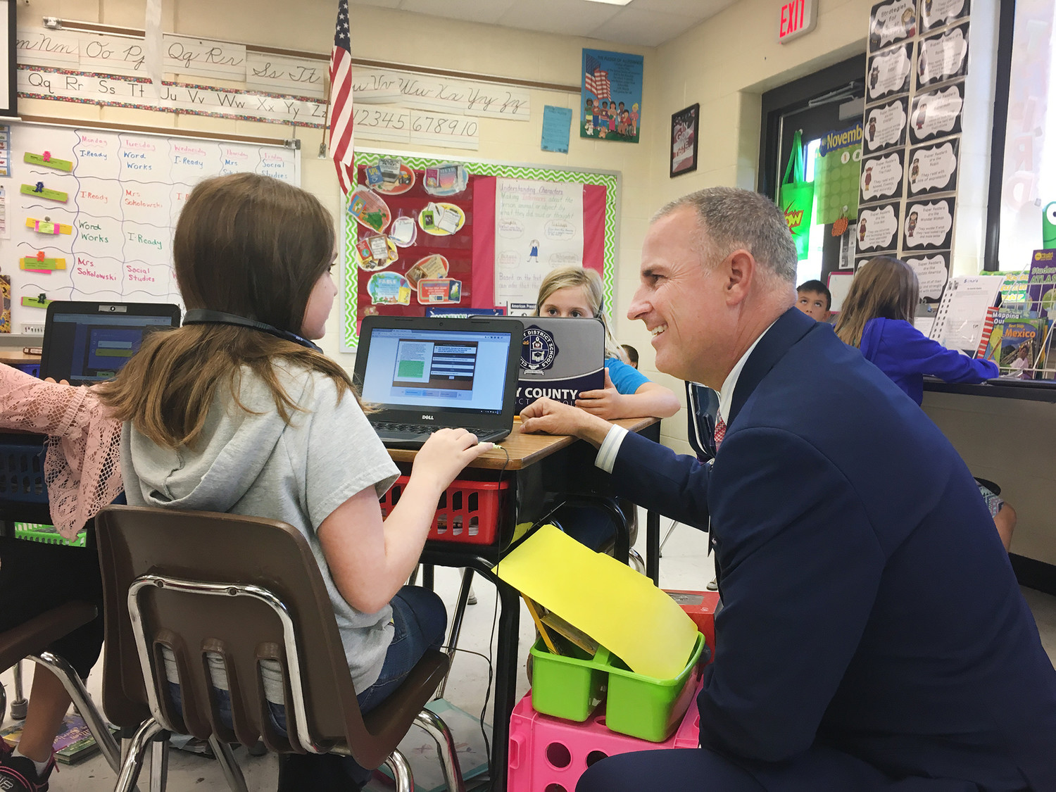 Clay County District Schools Superintendent Addison Davis talks with a student at Tynes Elementary School last week while touring the school to observe technology improvements implemented by the district.