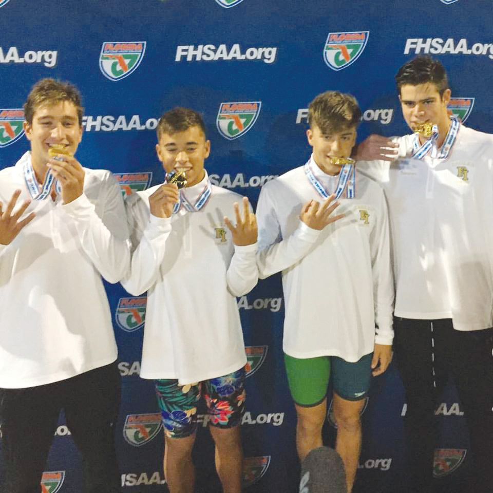 Fleming Island High's boys 200 free relay team; left to right, Nick Hackett, Jack Neeley, Andrew Heinton and Jacob Thompson, pulled off a third straight gold medal performance at the Class 4A championships held November 10 in Stuart. See more coverage, page 22.