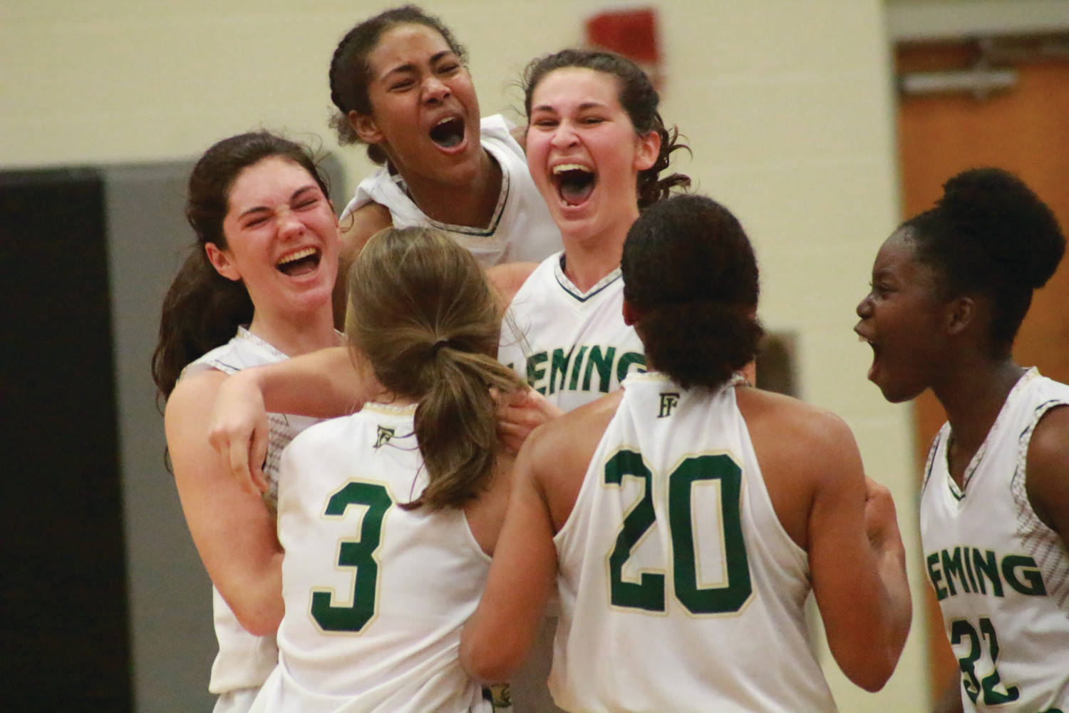 Fleming Island basketball celebrates after beating 7A-power Nease on a Molly Ragle, top right, three pointer at the buzzer.