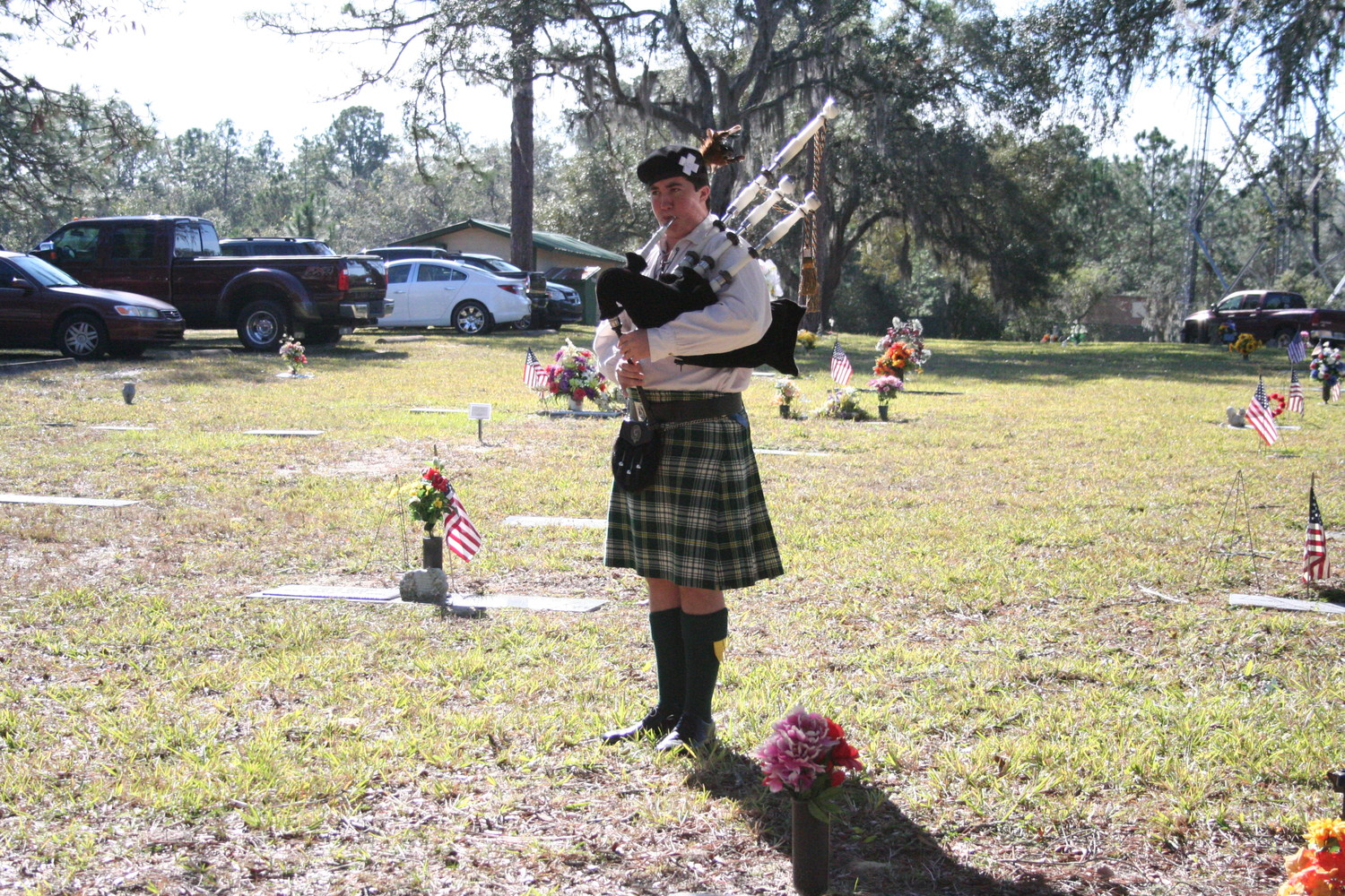 "Scotland Bolan of the First Coast Highlanders played ""Amazing Grace"" and taps, the bugle call for ""lights out,"" which is also sounded at military funerals, as well as each military branch's theme song during the Wreaths Across America event Dec. 16 in Keystone Heights."
