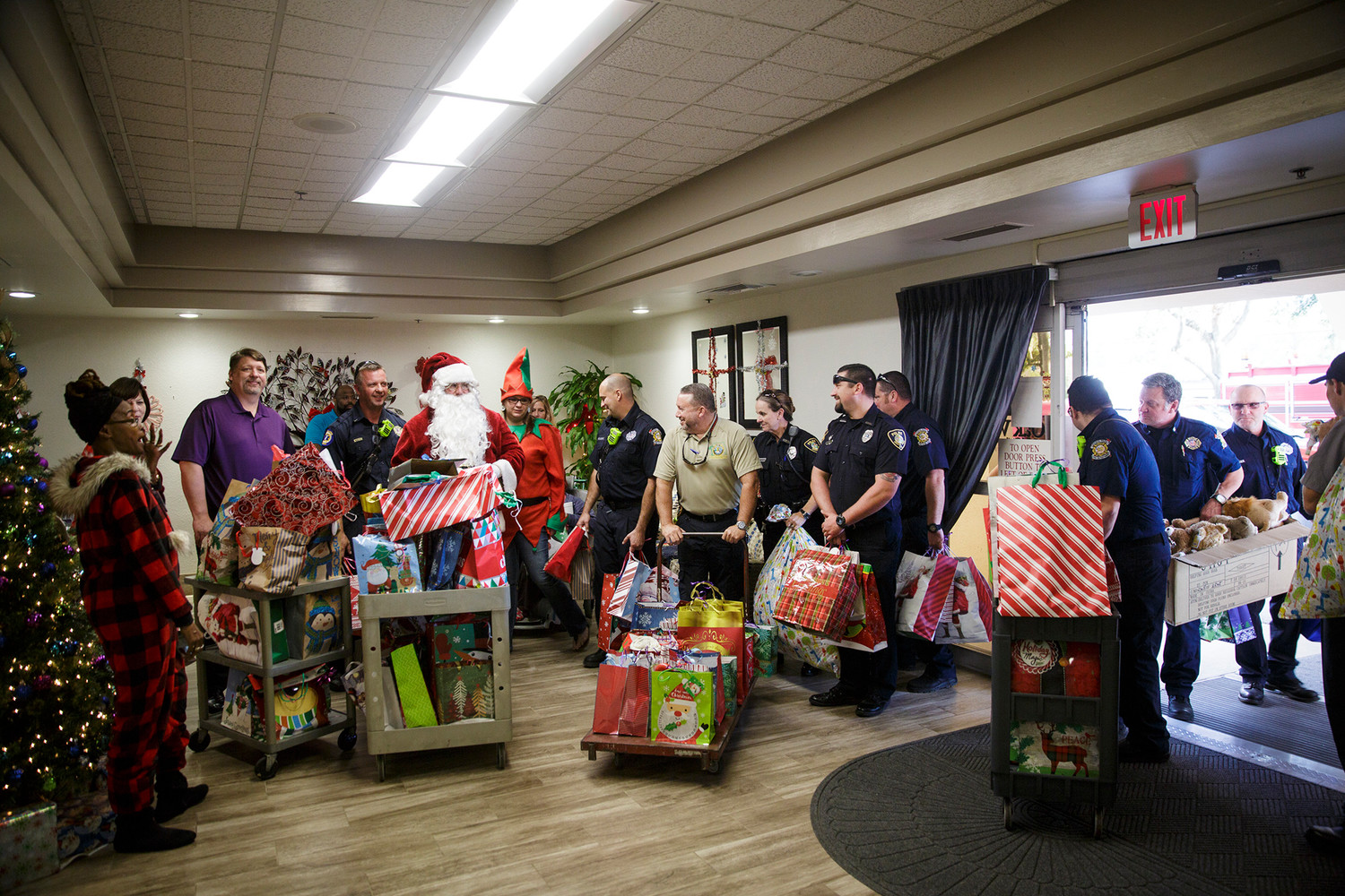 Members of the Orange Park Police Department and Fire Department delivered gifts Thursday at Oak View Rehabilitation Center in Orange Park as part of the annual Home Instead Christmas gift deliveries.