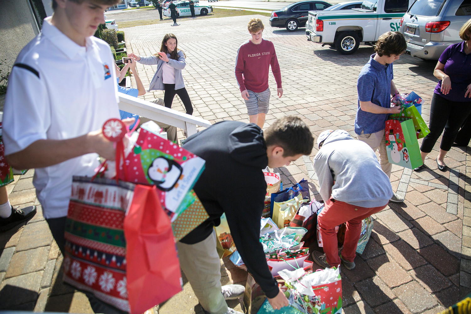 Volunteers from a Ponte Vedra boy's basketball team helped to organize and transport gifts at Home Instead Senior Care in Orange Park before the gifts were delivered to three locations in the businesses service area.