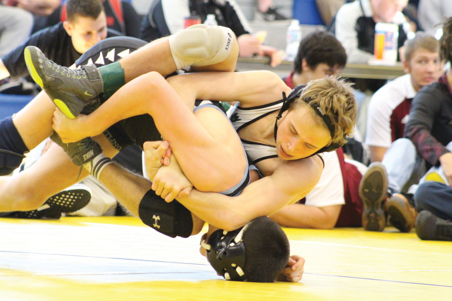 Fleming Island High 122 pounder wrestler Albie Snedaker, on top, drives head of South Dade's Bretli Reyna into mat in their Knockout Christmas Tournament semifinal match on Saturday. Snedaker lost match but finished fourth in weight class.