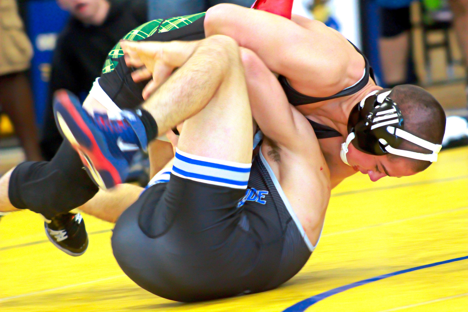 Fleming Island High 108 pound wrestler Lou Gagliardo gets South Dade's Luis Peraza about two inches from pin in their Knockout Tournament semifinal match on Saturday.