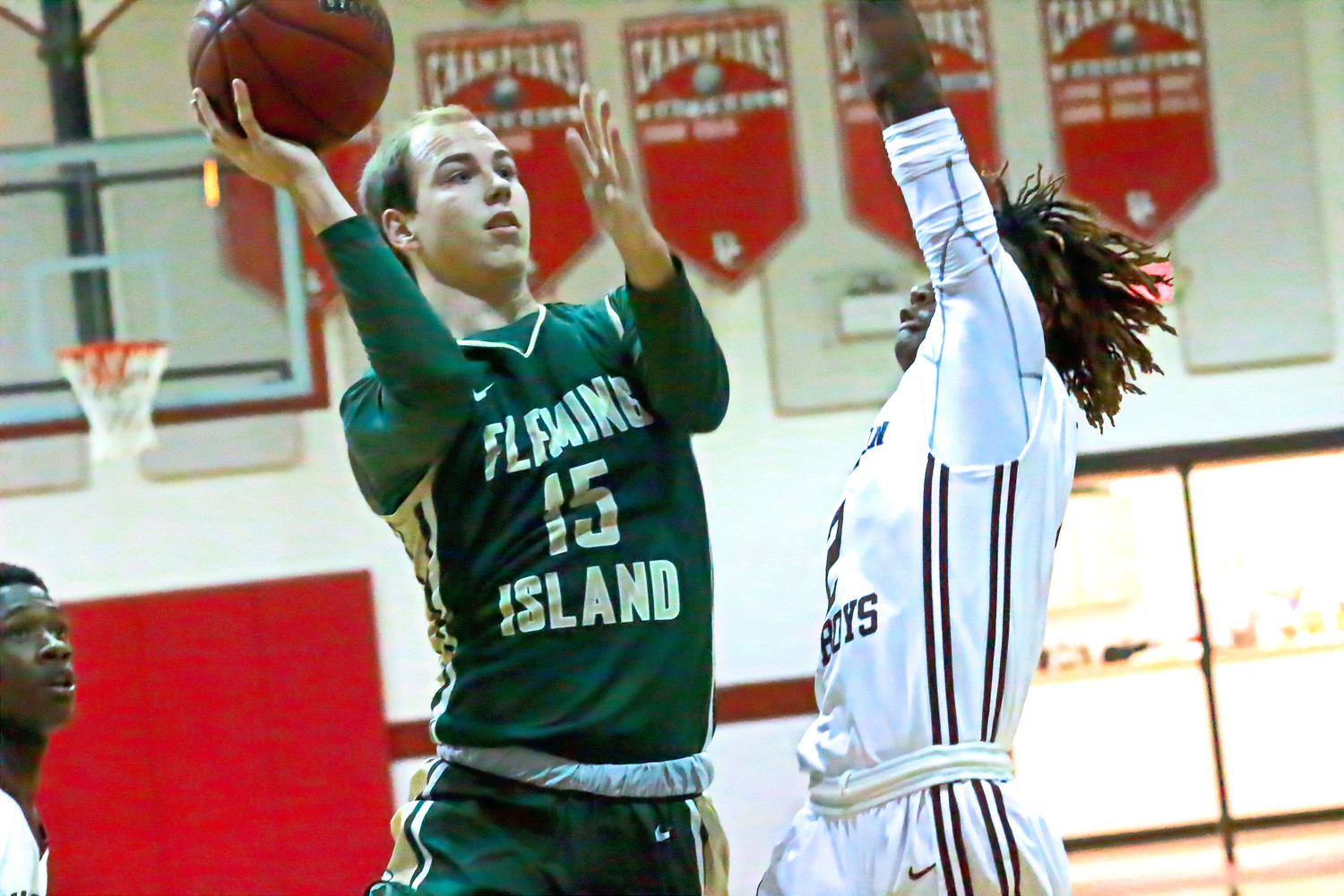 Fleming Island High guard Zach Gagne goes for one-hander in Golden Eagles semfinal game against Madison County at Baker County Christmas Tournament.