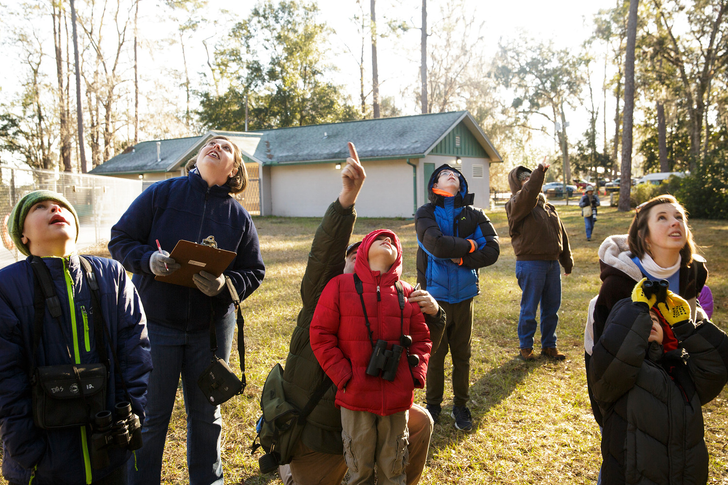 Participants in the Duval Audubon Society's annual Christmas Bird Count for Kids look for a red-bellied woodpecker Saturday at Camp Chowenwaw.
