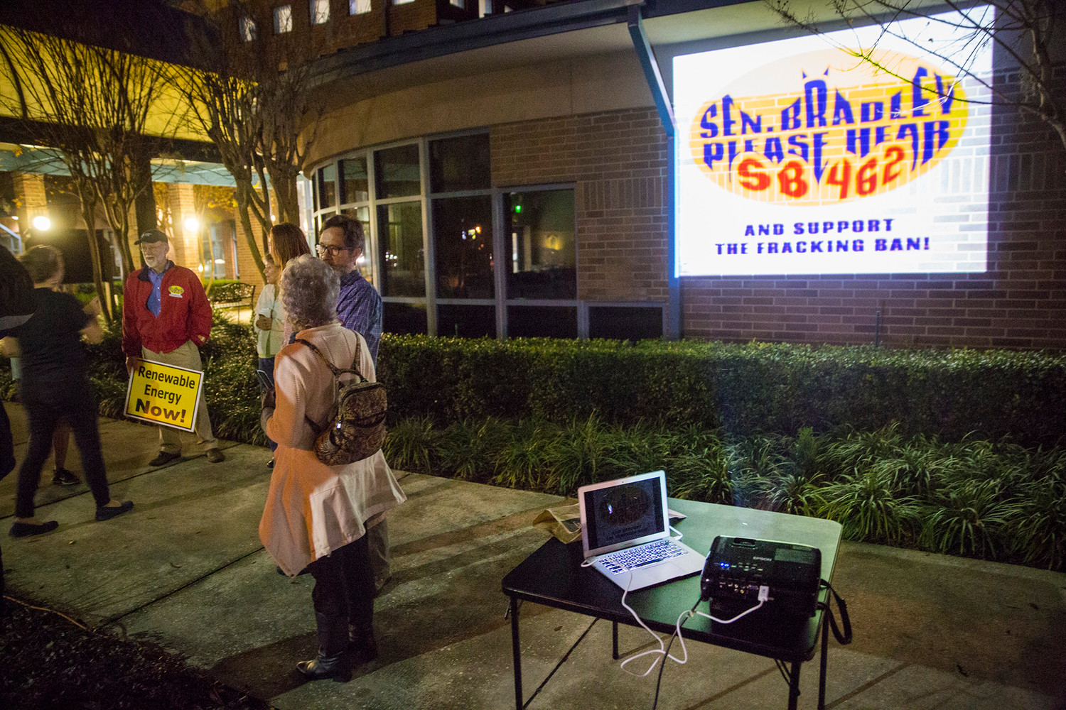A group containing Sierra Club members and Doug Miller of reThink Energy Florida met outside Orange Park Town Hall last Thursday evening to project a Bat Signal-style graphic onto the building calling for Sen. Rob Bradley's help in passing Senate Bill 462 and keep fracking out of Florida.