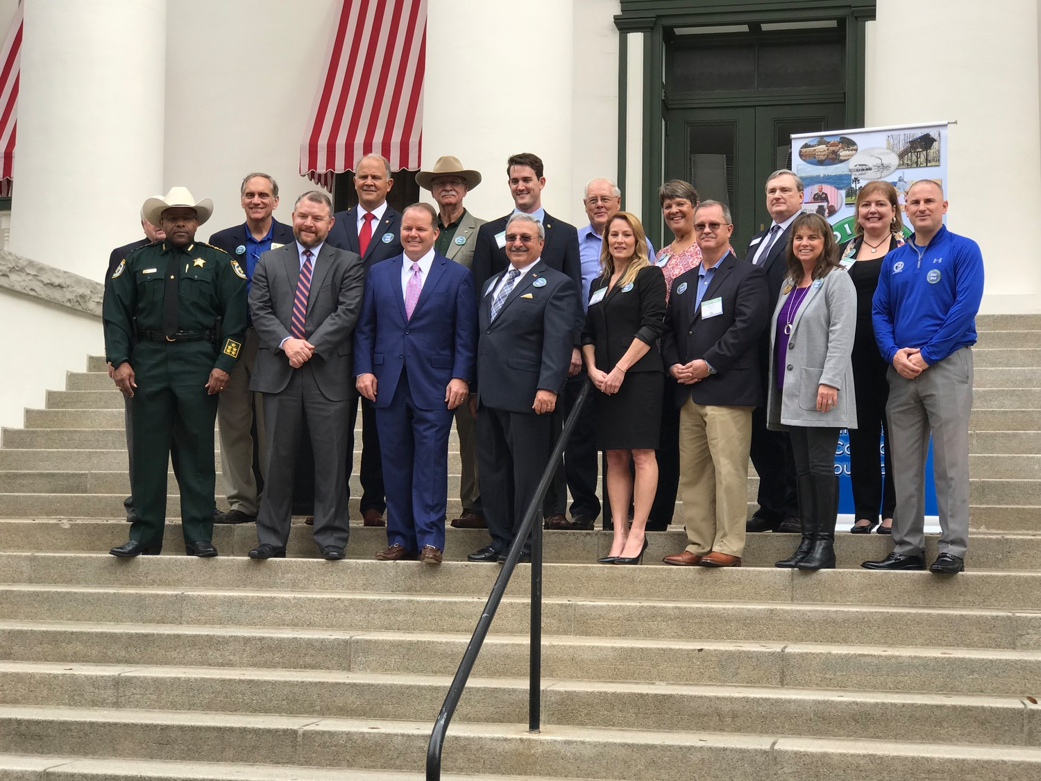 Sherriff Daryl Daniels, Senator Rob Bradley, Representative Tavis Cummings, Commissioner Wayne Bolla, Clerk of the Court Tara Green, Property Appraiser Roger Suggs, School Board Member Janice Kerekes, School Board Superintendant Addison Davis, back row, Orange Park Town Councilman Ron Raymond, County Board of Commissioner Mike Cella, Representative Bobby Payne, Board of County Commissioner Gayward Hendry, Board of County Commissioner Chair Gavin Rollins, Penney Farms Councilman Tom DeVille, School Board member Mary Bolla, Orange Park Town Councilman Alan Watt, Orange Park Town Councilwoman Connie Thomas.