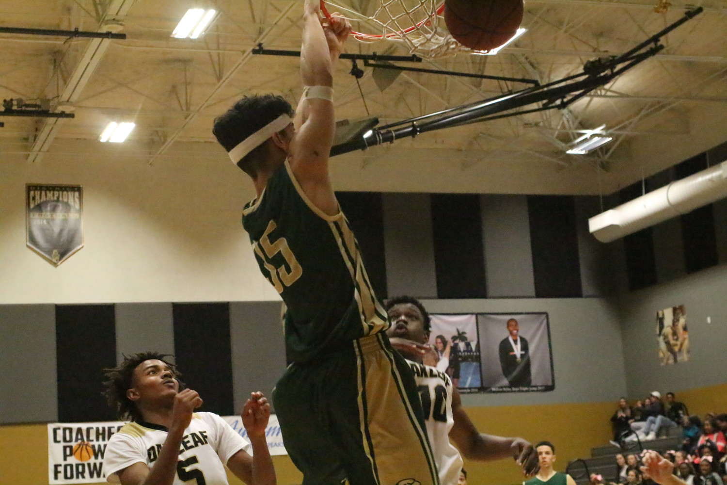Fleming Island forward Gianfranco Grafals puts down dunk against Oakleaf in Golden Eagles 85-75 district win on January 16.