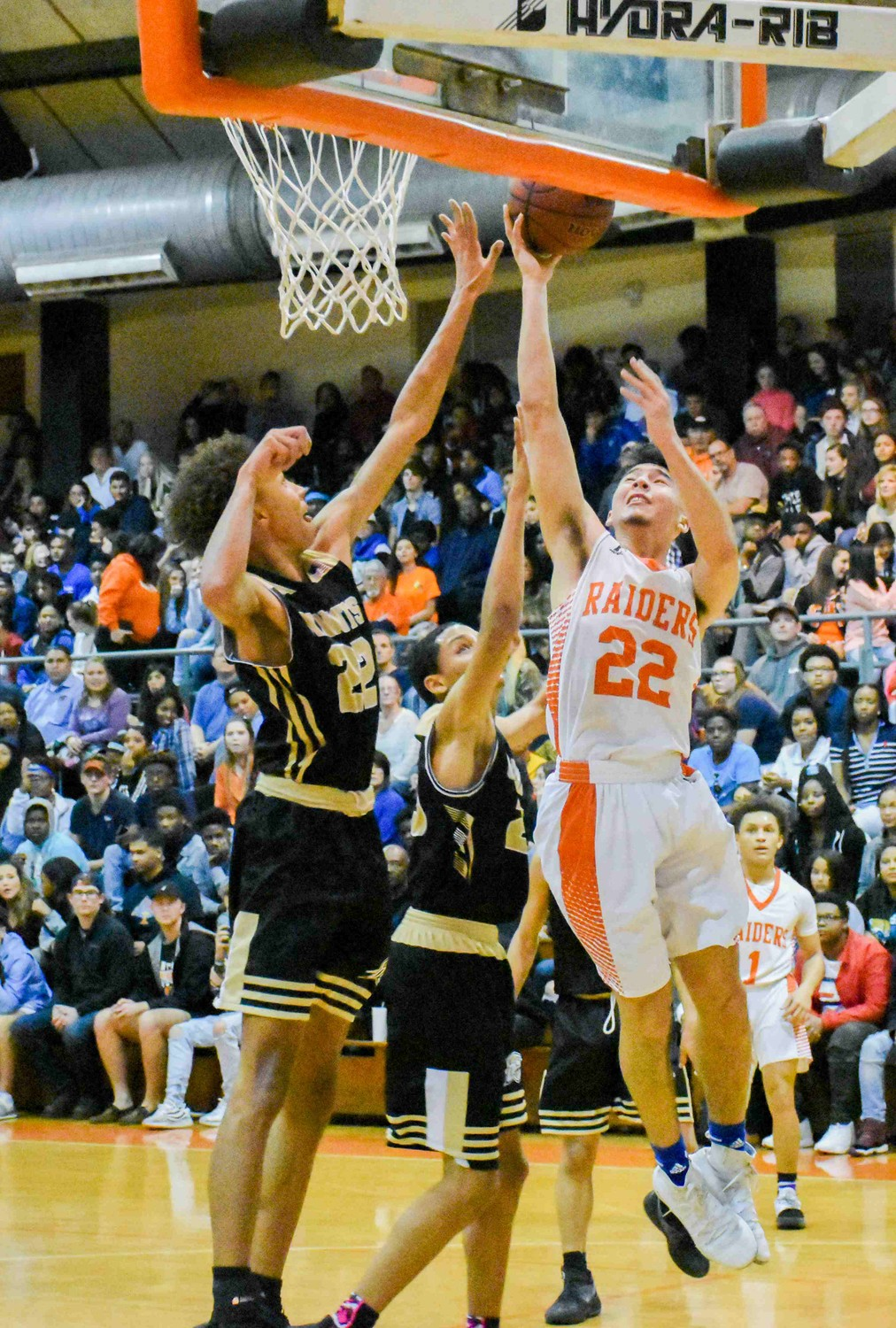 Orange Park High guard John Abate goes up for shot against Kameron McKenzie in Knights' non-district win Friday night at Orange Park High's Raiderdome.