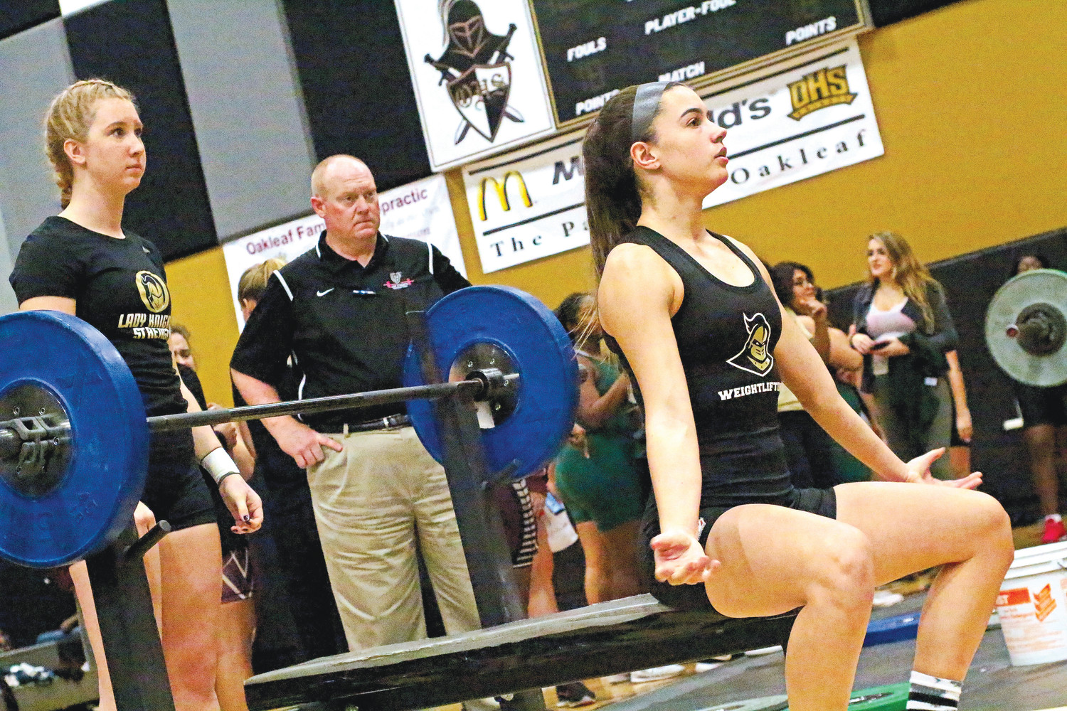 Oakleaf High senior weightlifter Lexi Perez readiers for bench press at district meet two weeks ago, Perez is second ranked at 154 for state meet scheduled Feb. 2-3 in Panama City.