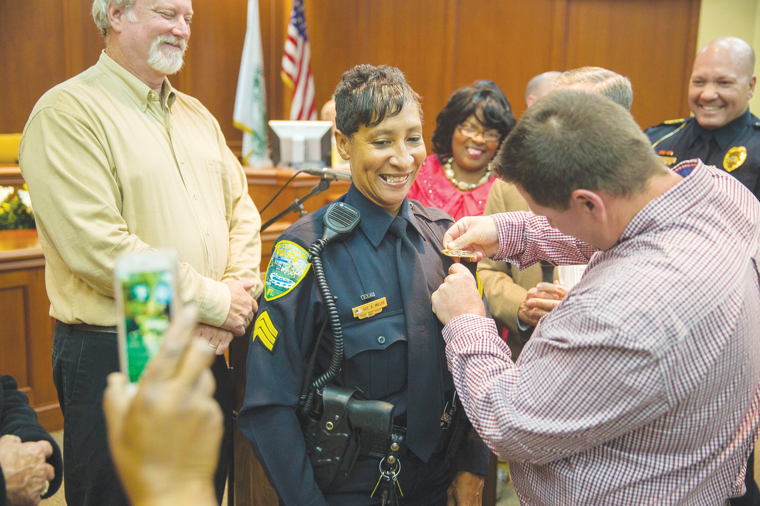 Green Cove Springs Police Officer Kimberly Miller is pinned by her husband after being promoted to the rank of sergeant Tuesday evening during the Green Cove Springs City Council meeting.