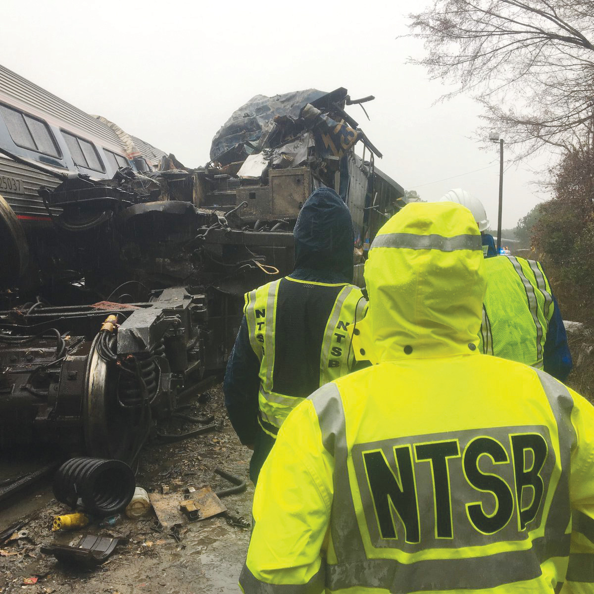 NTSB investigators inspect the Amtrak Train 91/CSX collision in Cayce, South Carolina.