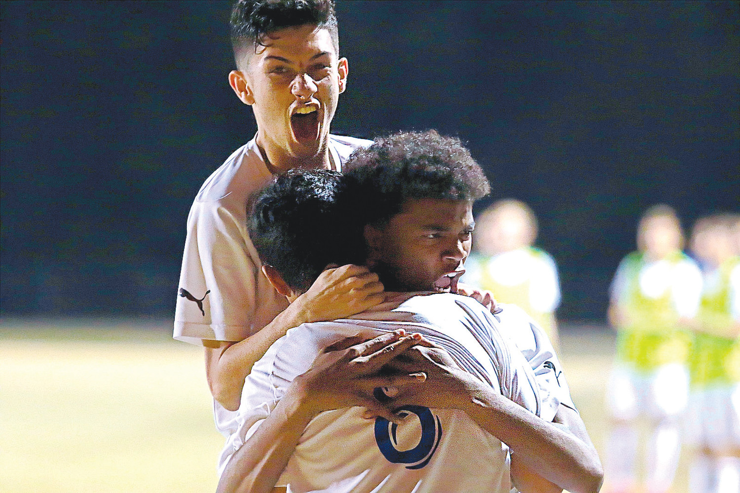 Ridgeview High boys soccer players Jose Ortiz, left, and Elias Martin, right, hug teammate Miguel Ortiz after his game winning goal in first minute of second half in Panthers' 1-0 win in their region 1-3A semifinal against Matanzas on Feb. 10.