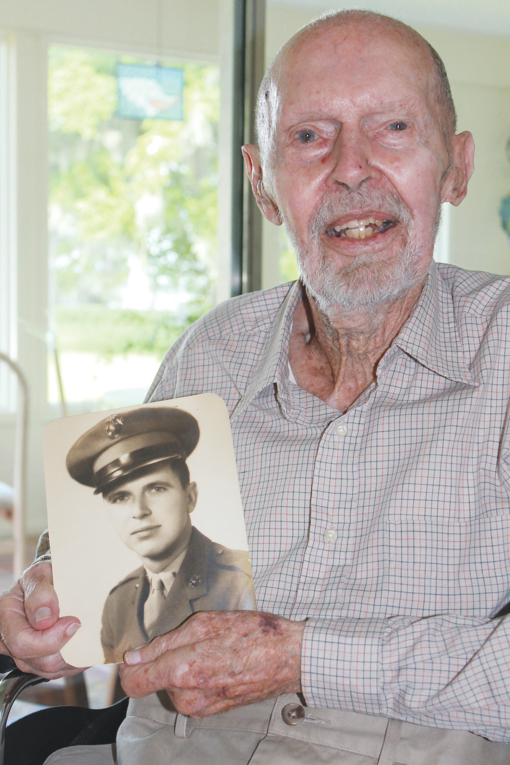 Retired U.S. Marine, John Hansen, shown here in a 2013 Clay Today file photo, was one of the pilots stranded in the Pacific Ocean in 1944 in what is known as The Flintlock Disaster. The tragic event is now chronicled in a new book.