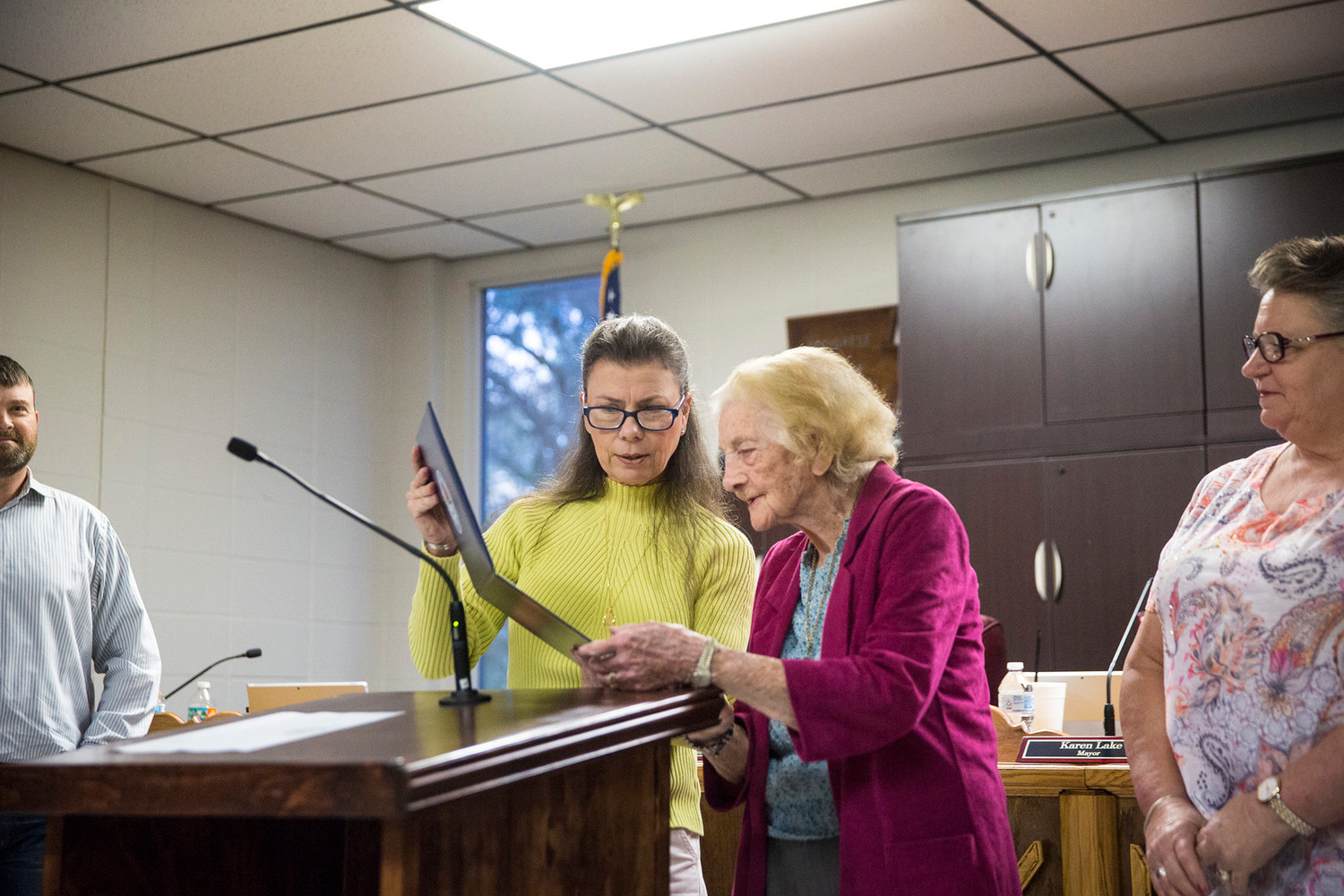 Keystone Heights Mayor Karen Lake presents a physical copy of a proclamation read during Monday's City Council meeting honoring the 100th birthday of Keystone resident Rachel Buff.