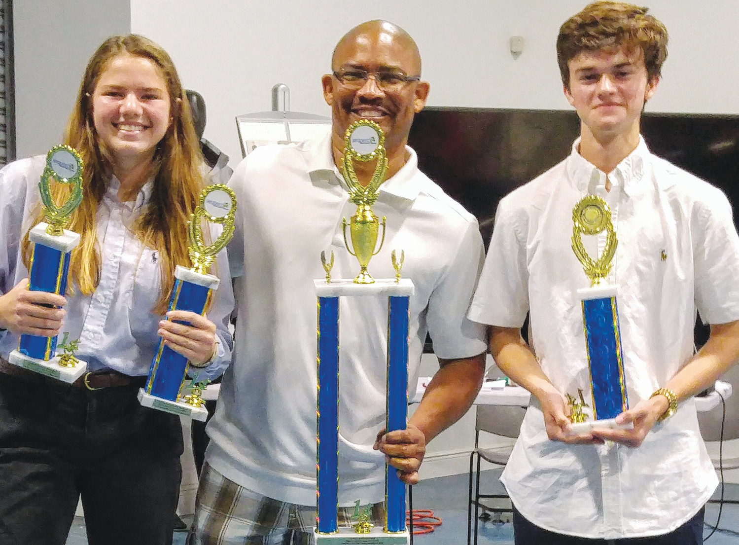 Fleming Island High sophomore Jordan Detwiler, left, stands with Gordon Connell, executive director of the Marine Industry Cares Foundation and Hetwiler Halibuts teammate Austin Hughes, a freshman, March 10 after capturing first place at the 2018 Marine Industries Cares Foundation SeaPerch Qualifier, held in Fort Lauderdale.