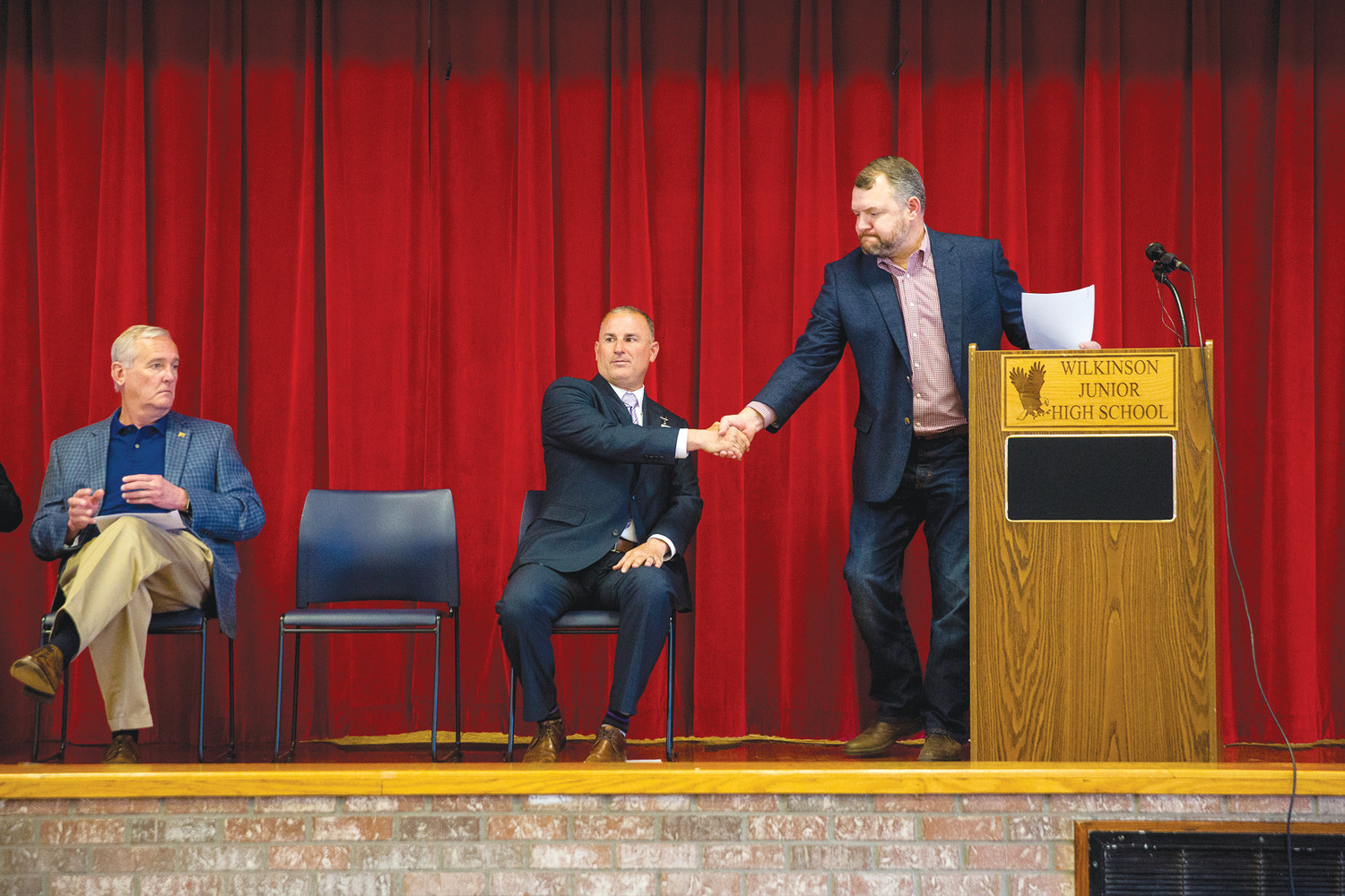 Sen. Rob Bradley shakes the hand of Clay County Superintendent Addison Davis during a presentation at Wilkinson Junior High School last week concerning the new Community Partnership Schools program that will begin this month at Wilkinson.