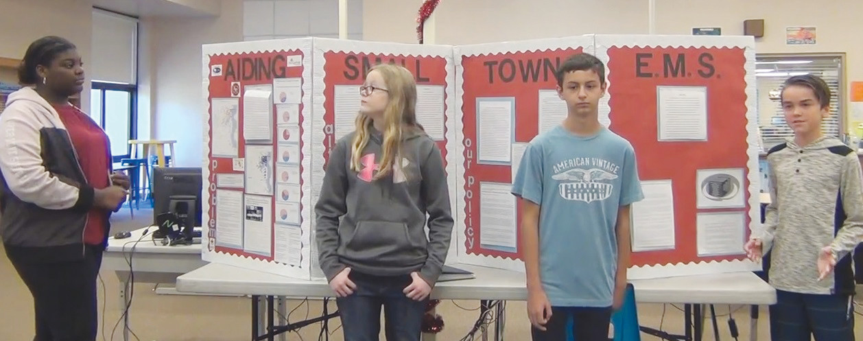Four students present their project on the need for local emergency medical services in Orange Park.