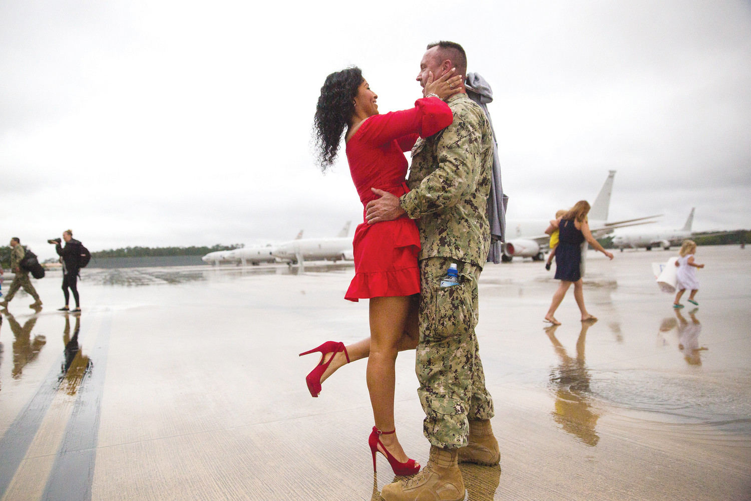 Green Cove Springs resident Susy Fiallos embraces her fiancé, Master Chief Mark Tapley, Tuesday morning after Tapley and the rest of the remaining members of VP-5 returned to Naval Air Station Jacksonville.