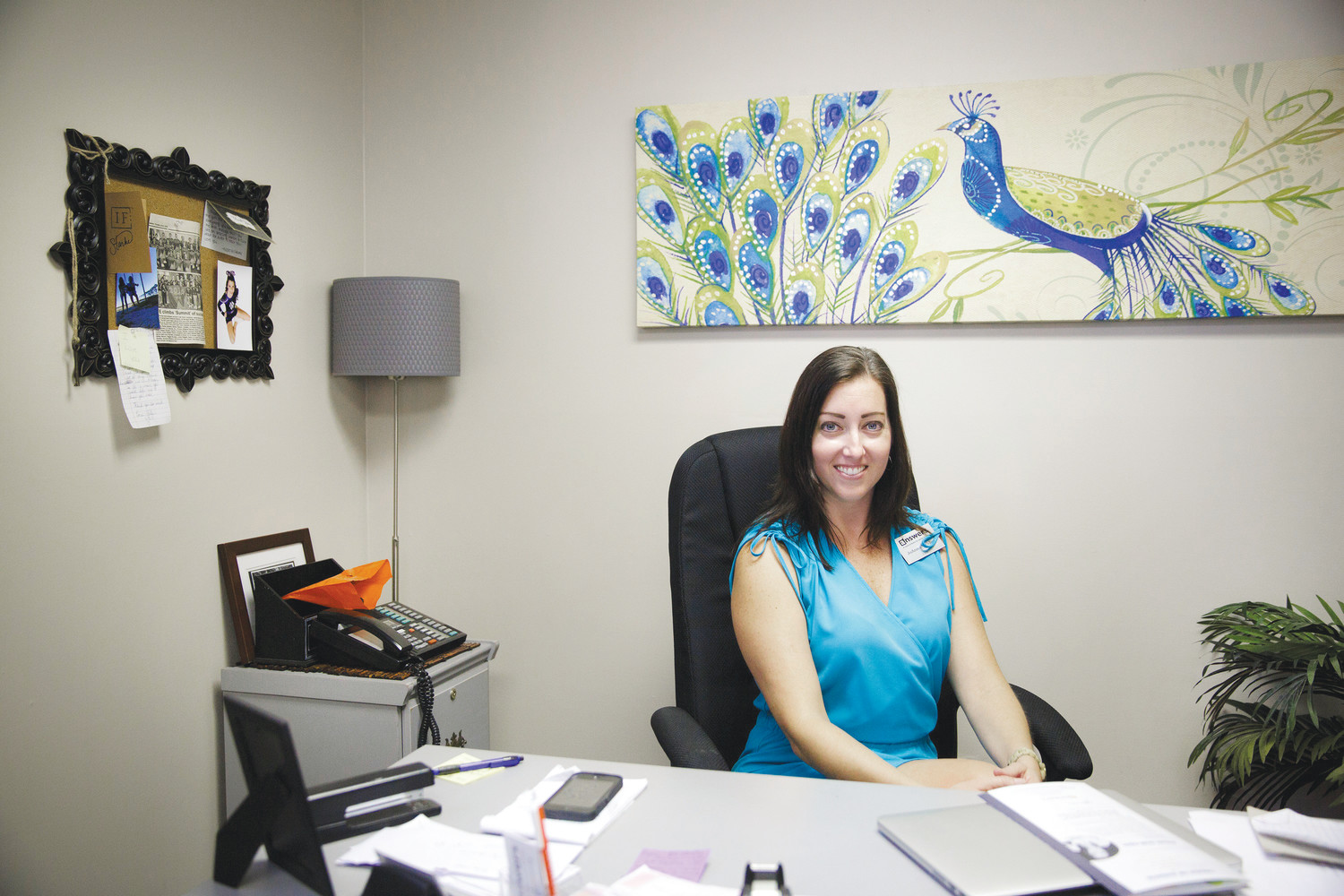 Answers CEO JoAnna Weldon sits in her office in the organization's Keystone Heights office. Weldon started Answers in 2011 to help meet the needs of women in Keystone Heights and the surrounding communities.