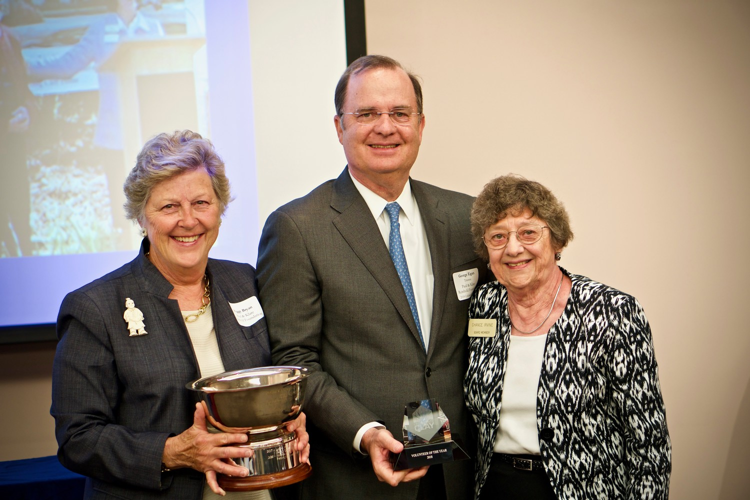 Paul and Klare Reinhold Foundation family members, far left, Peggy Bryan, and George Egan, stand with Penney Retirement Community board member Chance Irvine, who is also a former member of the Florida House of Representatives, holding the Volunteer of the Year Award at the 2018 Celebrate Clay Awards.