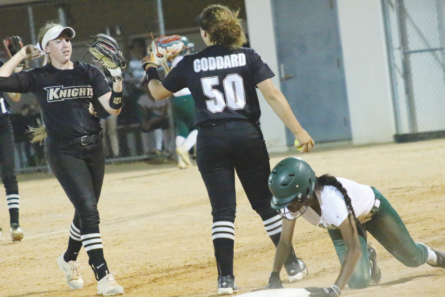 Oakleaf High got a stellar double play from second baseman Rebecca Koskey, left, and third baseman Baylee Goddard in late innings of Knights' 2-1 region playoff win over Lincoln.