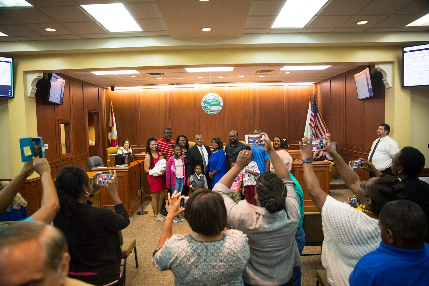 Audience members try to get a photo of newly appointed Green Cove Springs Mayor Connie Butler Tuesday evening after the council voted unanimously to put Butler in the position. Council member Steven Kelley was appointed Vice Mayor by the same vote.