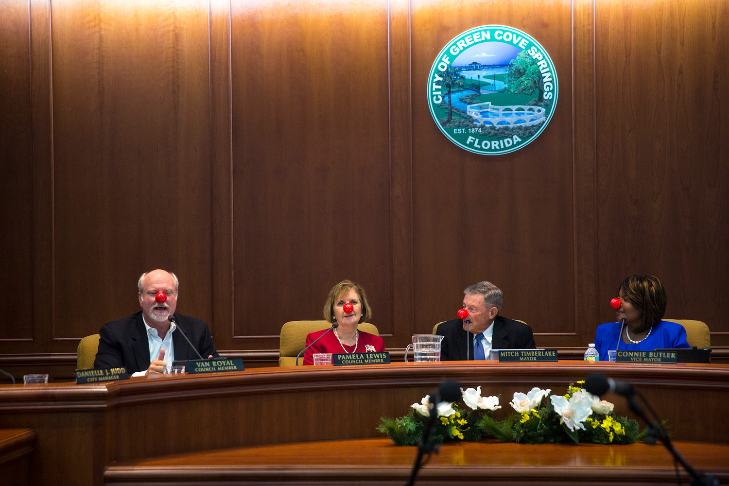 Green Cove Springs council members, from left, Van Royal, Pam Lewis, Mitch Timberlake, and Mayor Connie Butler wear red noses Tuesday evening passed out by Royal for Red Nose Day on May 24.