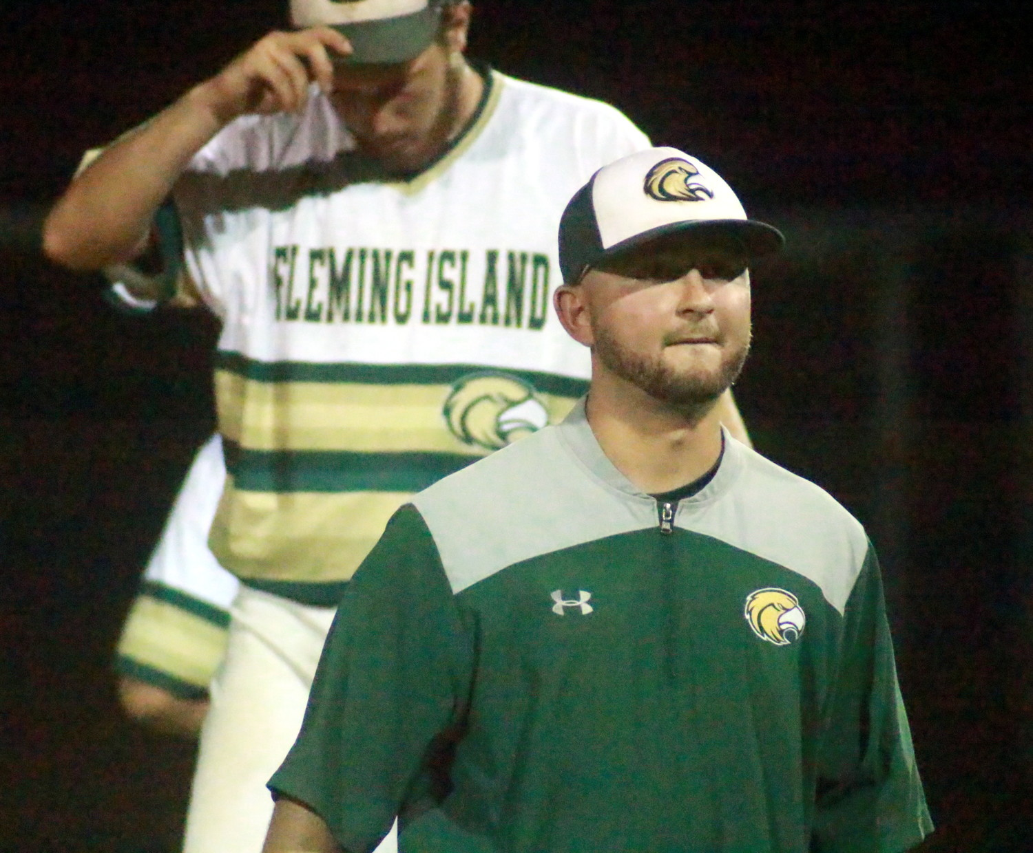 Fleming Island High baseball coach Grant Bigilin, front, got rugged play from senior pitcher Caleb Lanoux in the Golden Eagles region final playoff run this year.