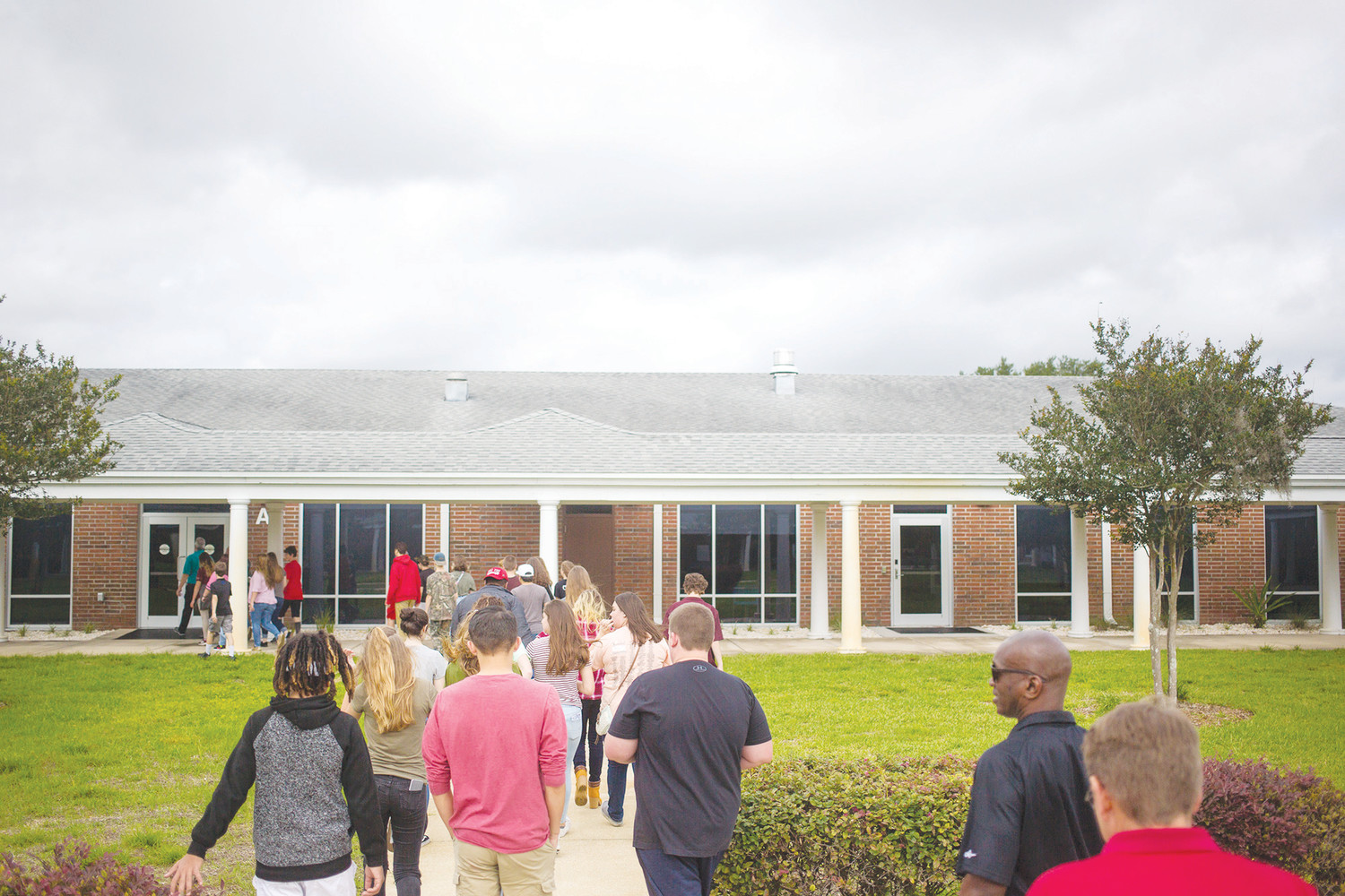 Wilkinson Junior High School students walk through the campus at St. Johns River State College Tuesday during a six-stop tour of the campus and some of their offerings for high school students and those just out of high school.