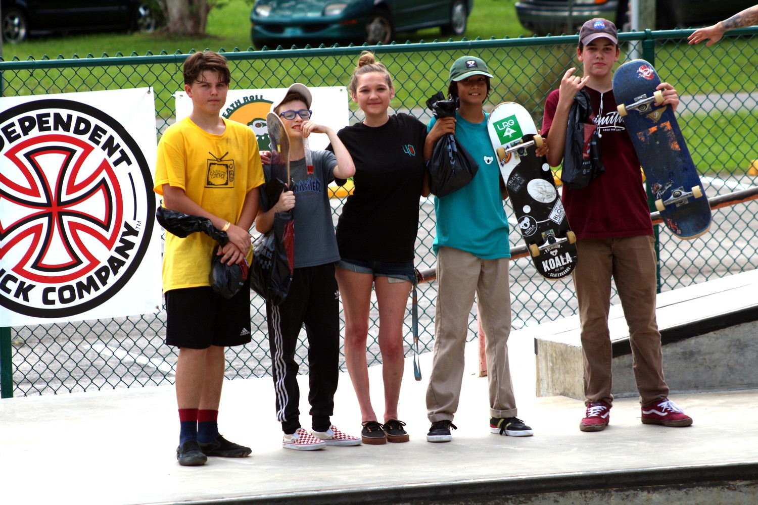 Winners in the 15-Unders included, left to right, Owen Kirkpatrick, Brody Harris (First place), prize girl Courtney Green, Marcus Caserias and John Lee.