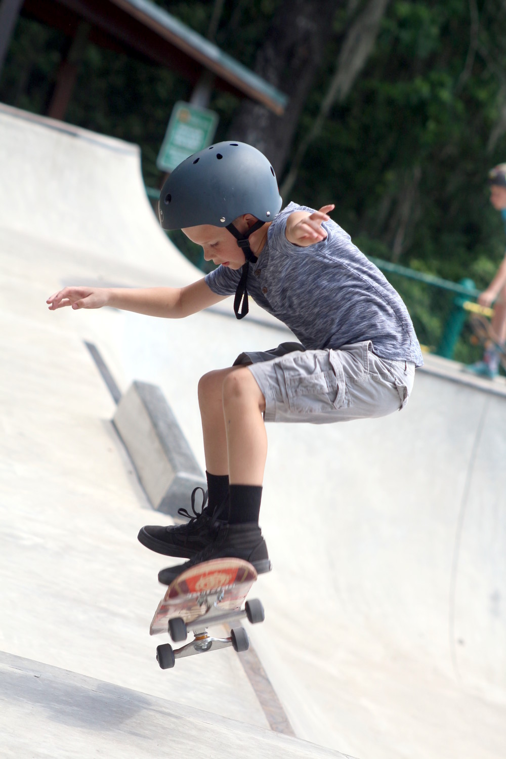 Nine year old Tyler Gold checked out a molly on the back side of the OP Skate Park course.
