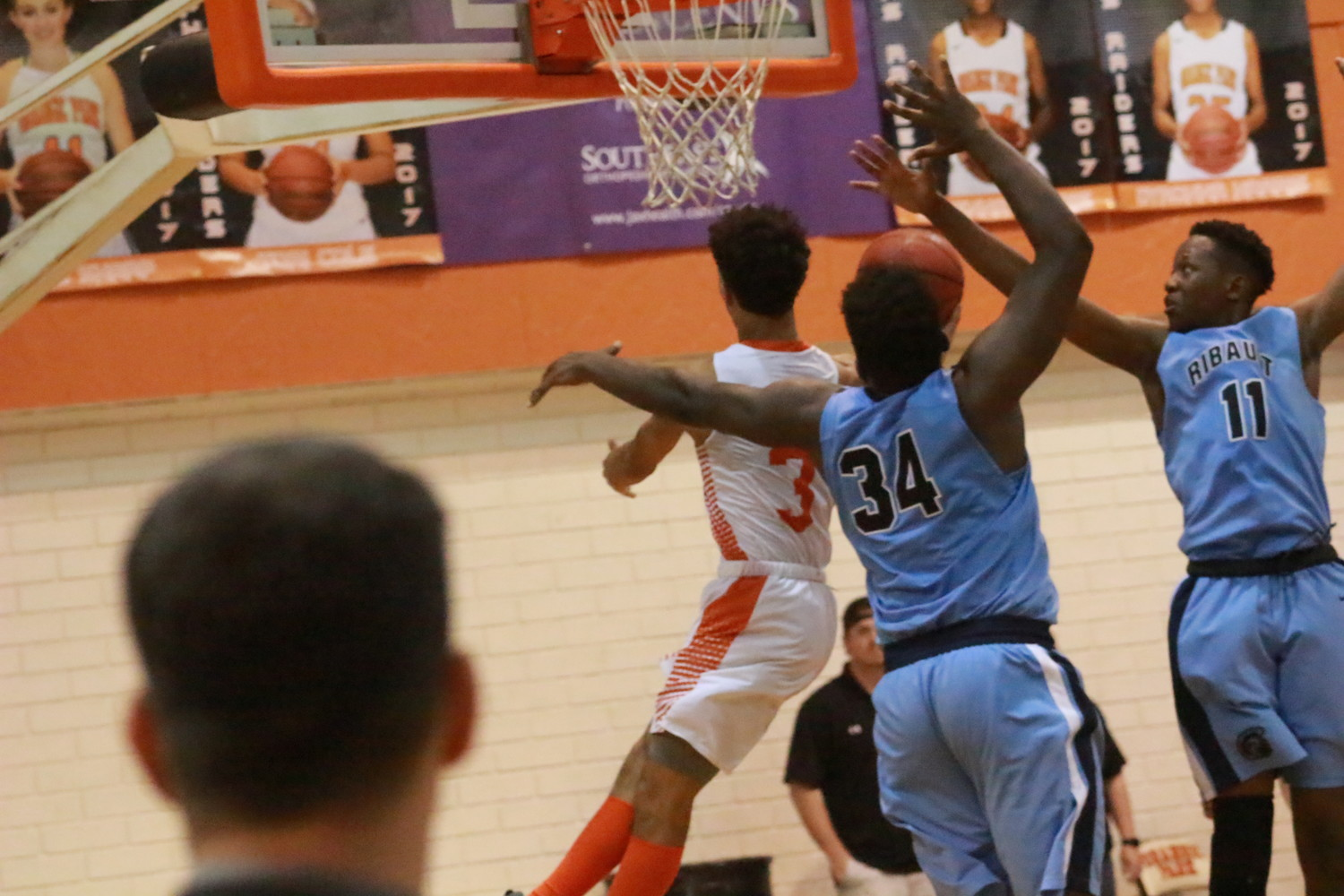 Orange  Park High guard Ty McBride sliced through two Ribault defenders to sink a layup and tie the Raiders' region playoff game with nine seconds on the clock to present a possible overtime period for the game. Ribault hit a court-length toss to win.