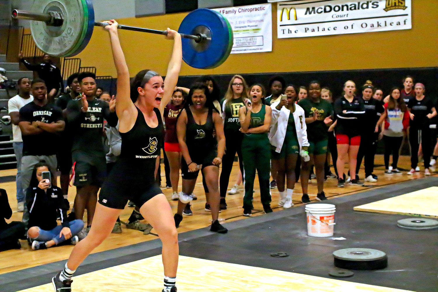 On her last lift of the competition, Oakleaf High's Lexi Perez overcame a strong challenge from Middleburg's Jay Pena.