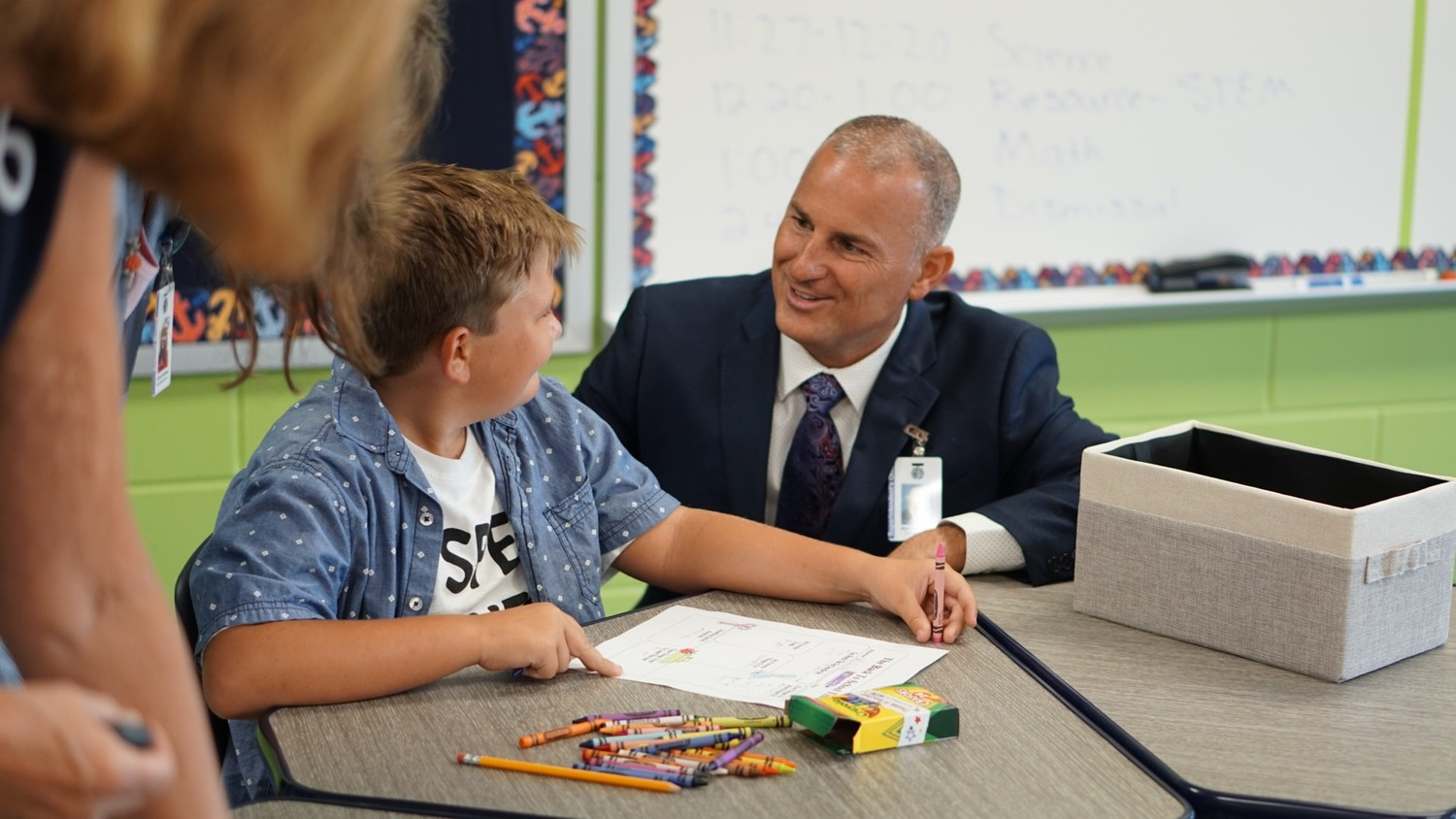 Clay County School Superintendent Addison Davis shares a smile with a Discovery Oaks Elementary student on the first day of school, which also marked the school's grand opening.