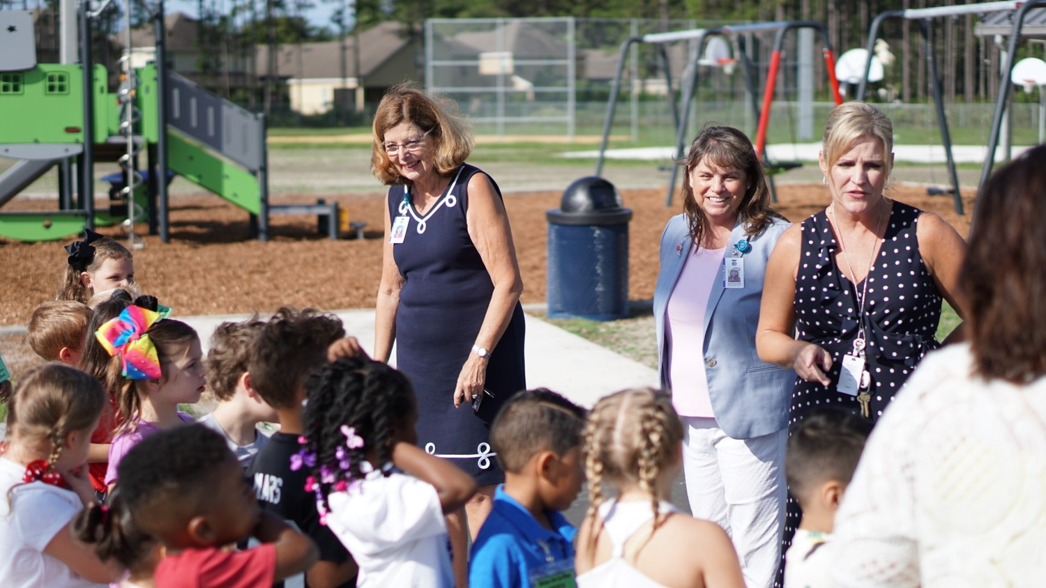 Clay County School Board Chairman Carol Studdard, center, and Vice Chairman Janice Kerekes join Principal Tracy McLaughlin at Discovery Oaks Elementary School's first day. The school is the district's first STEAM school in that it adds the Arts to Science, Technology, Engineering and Math as key pillars of its curriculum.