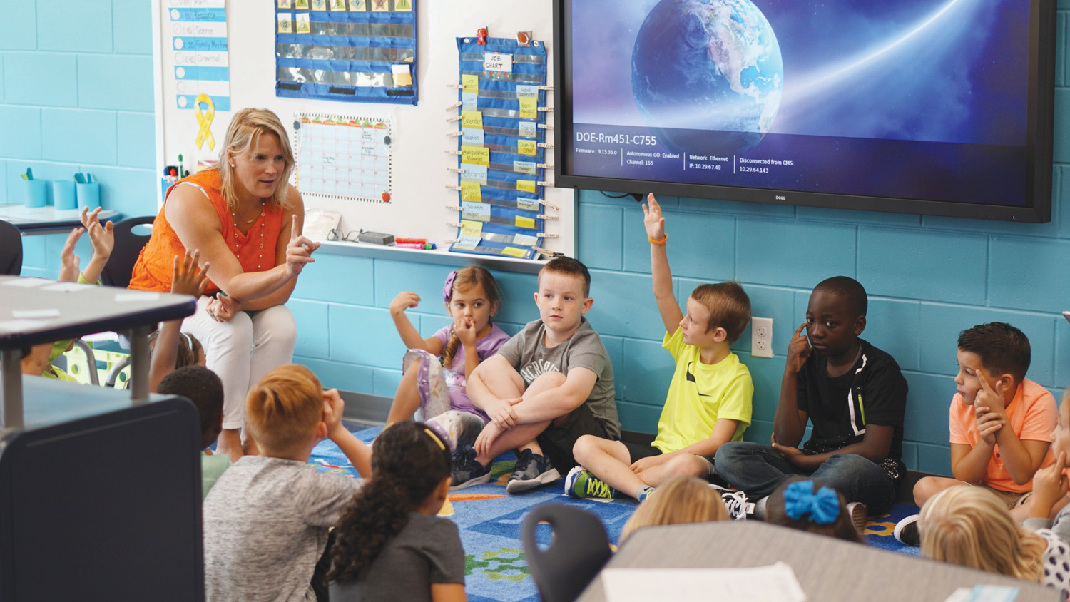 Students take part in a first day of school icebreaker exercise Aug. 14 in Ashley Chaney's 2nd grade class at Discovery Oaks Elementary, Clay County's first new school since Aug. 16, 2010 when Oakleaf High opened. The $23 million school did not require any financing by the district.