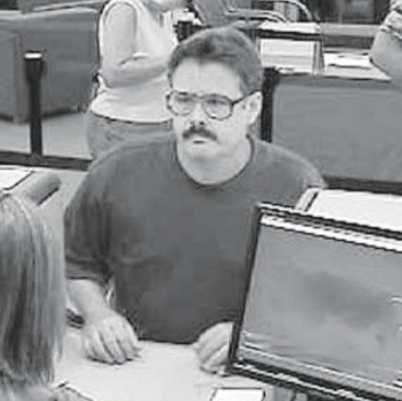 2010 file photo of surveillance footage to show how he aged