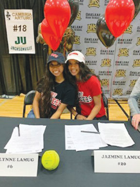 Oakleaf High sisters Caitlynn and Jazmine Lamug signed together to play at Northwest Florida State College in Niceville, FL.