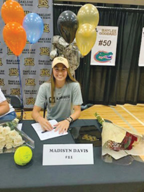 Oakleaf High softball pitcher Madyson Davis signed to play next at the University of Central Florida in Orlando.