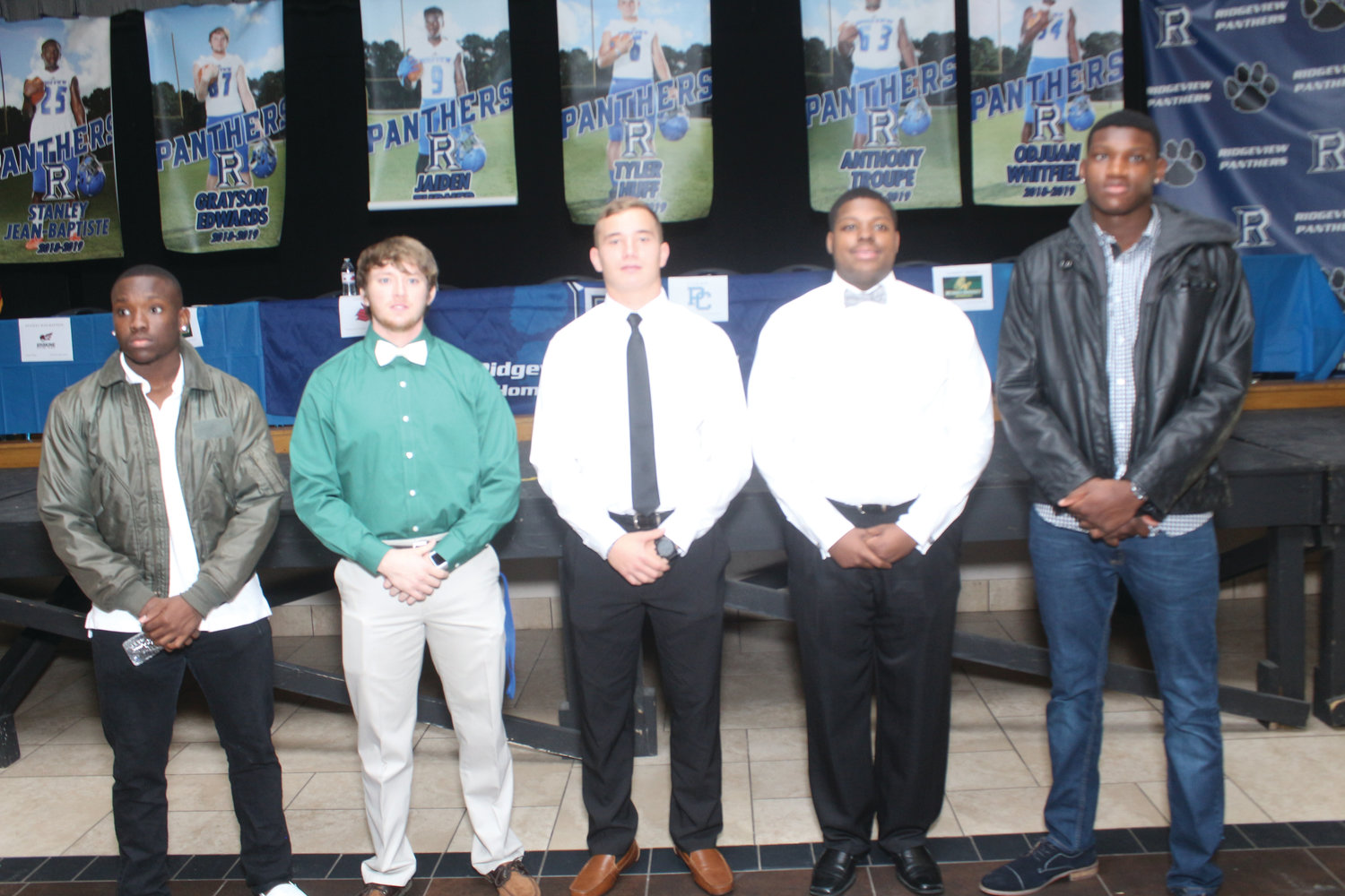 Ridgeview High's football signees, l-r, Stanley Jean-Baptiste heading to Geneva College in Beaver Falls, PA; Grayson Edwards, wide receiver, heading to Methodist University in North Carolina; Tyler Huff, quarterback, heading to Presbyterian College in South Carolina, Anthony Troupe, offensive lineman, heading to Methodist University and Odjuan Whitfield, defensive end, heading to Troy University in Alabama in morning signing ceremony at Ridgeview High School.