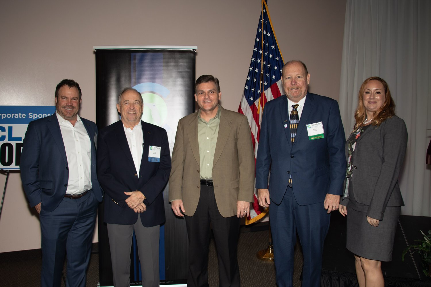 From left, Monte Lambert from event-sponsor Wantman Group Inc., Jerry Agresti of Developers Realty Group, Jeff Sheffield, from the Clay EDC Board of Directors and North Florida TPO Executive Director, Walter Kloss and Eliza Partingon, both of Wantman Group, share the stage at the EDC's first quarter luncheon.