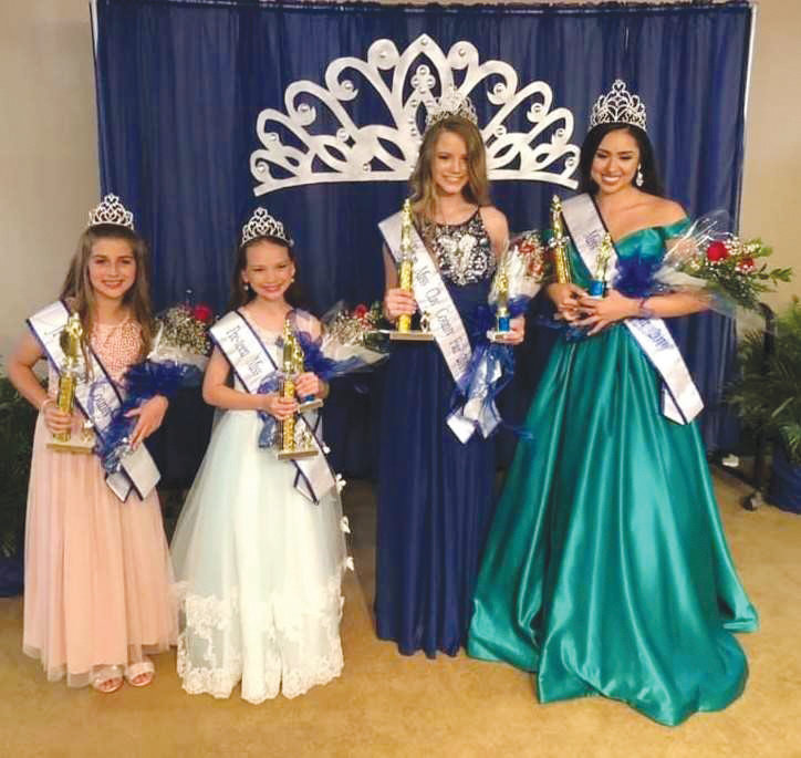 From left: Sadie Pouncey, Junior Miss, Hailey Alilio, Pre-Teen Miss, Mattie Hancock, Teen Miss, and Lillian Wonpat, Miss Clay County Fair.