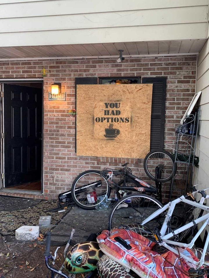 "CCSO left its calling card -- ""You had options"" with a cup of coffee stenciled over a window broken during Thursday morning's SWAT raid."