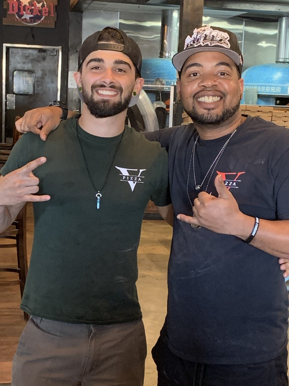 Michael Newman and Carl Davis are two of the few still on the job at V Pizza and Tap Room.