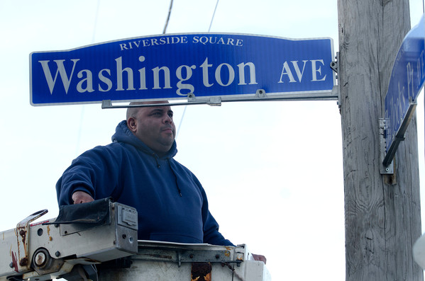 East Providence Public Works/Highway Department employee David Laughlin installs one of the many new streets signs in Riverside Square as part of the Riverside Renaissance Movement's effort to beautify the area. For more on the new street signs turn to page 3.